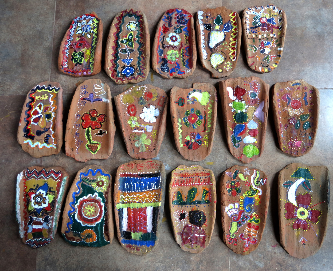 Art work by children in Maihar on khaprel tiles (image courtesy: Nobina Gupta).