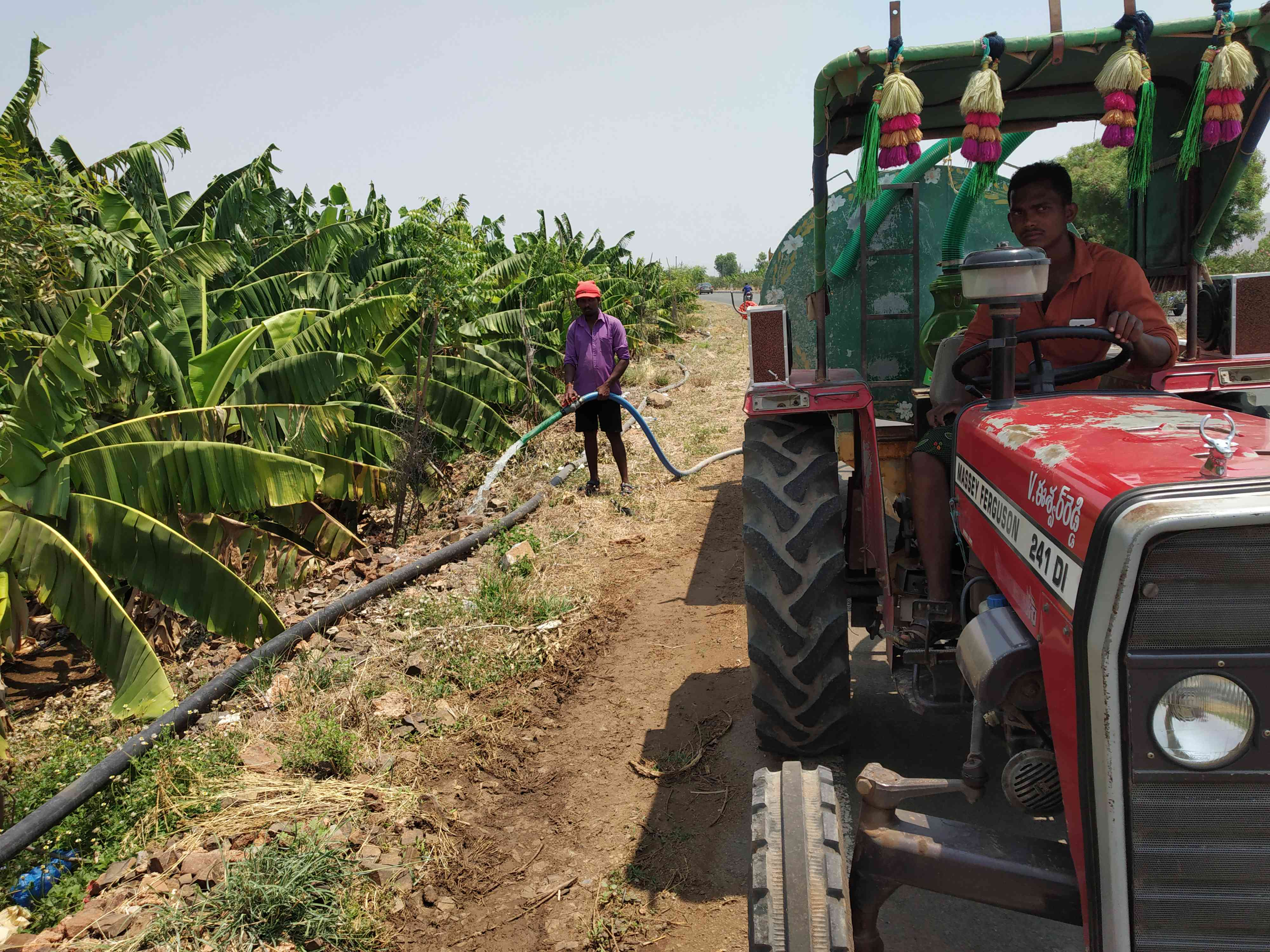 A farmer in Kadapa watering his plantain farm. The water is bought from private suppliers at Rs 500 per 5,000 litres. Photo credit: Sruthisagar Yamunan
