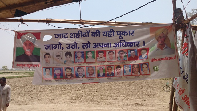 A poster at Jasiya, Rohtak with photos of the Jats killed by the police in the February agitation along with Chhotu Ram and Bhagat Singh.