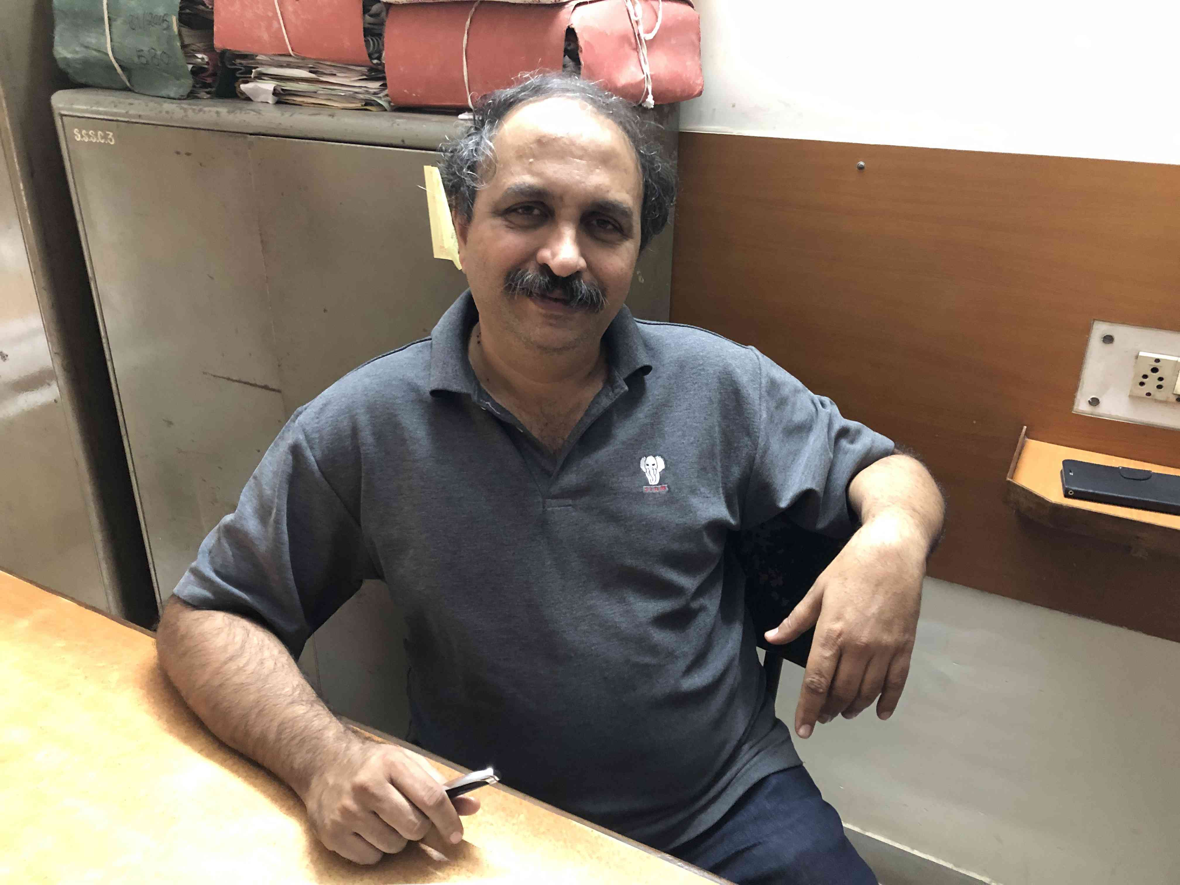 Milind Ranade, general secretary of Kachra Vahtuk Shramik Sangh, in his union office in December. (Photo credit: Milind Ranade).
