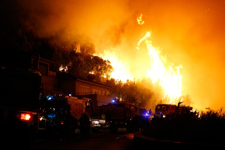 Around 160 firefighters and more than a dozen fire engines are battling the blaze in Biguglia. (Credit: Pascal Pochard-Casabianca/AFP)