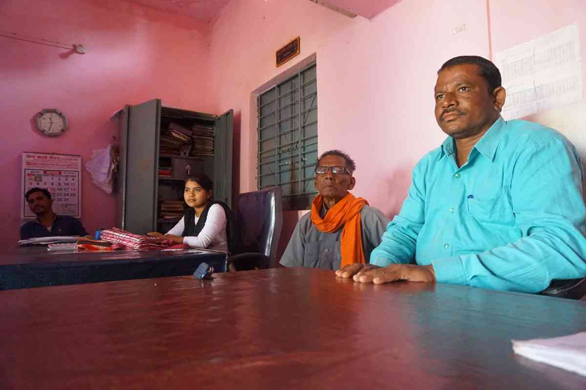 Inside the panchayat office, Kunjam, the sarpanch, sits the right of Nag, the former sarpanch wearing a saffron stole.