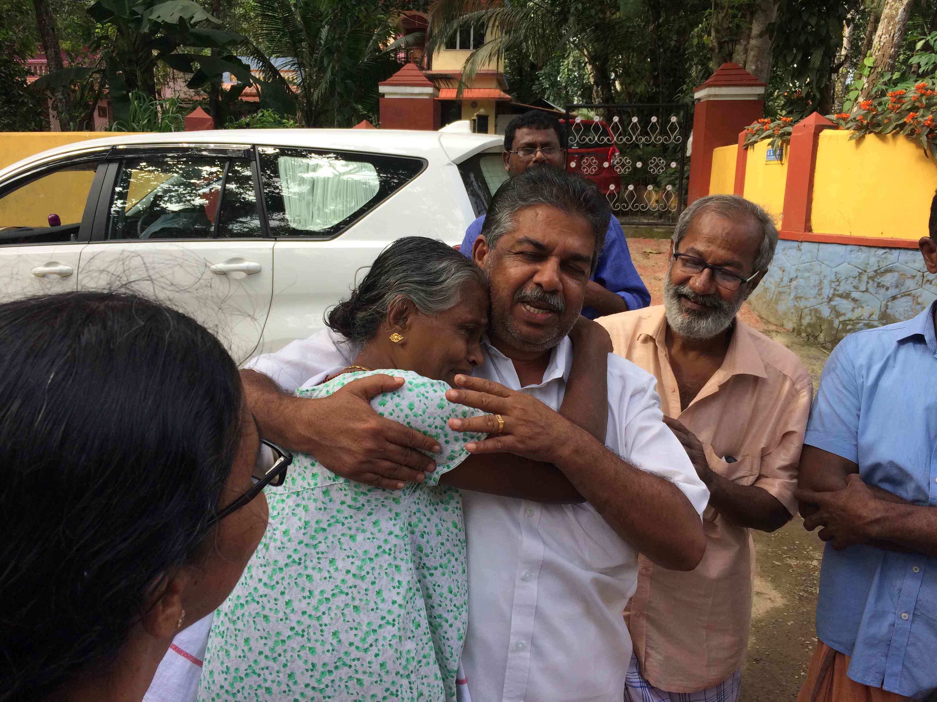 Chengannur MLA Saji Cherian consoles a flood victim at a relief camp.