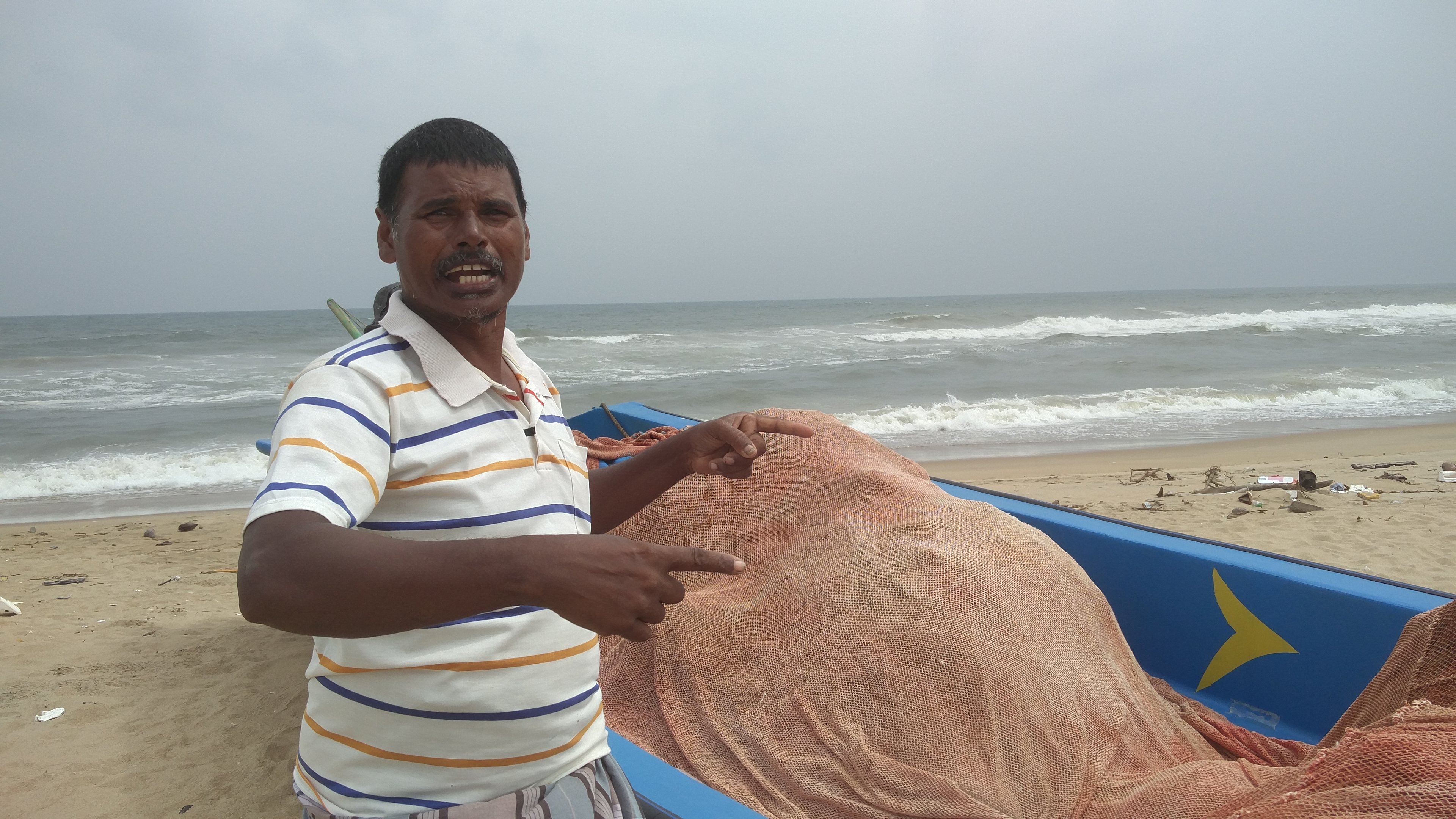 Palayam, president of the Ururkuppam Fishermen Cooperative Society, says the Adyar's waters contain high levels of chemical waste. (Credit: Vinita Govindarajan)