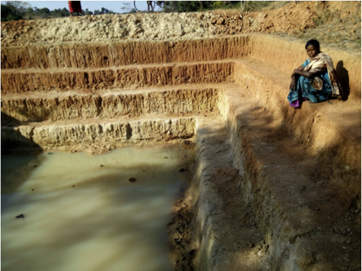 Roshani Gudiya sits by a farm pond completed under MGNREGA.
