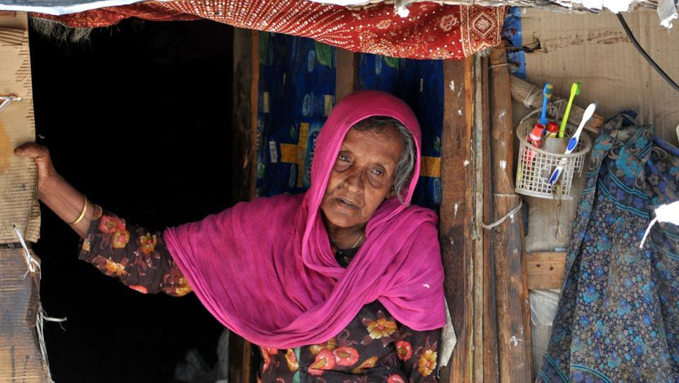 A Rohingya woman stands at the entrance of her temporary home at a refugee camp in Jammu. (Photo credit: HT).