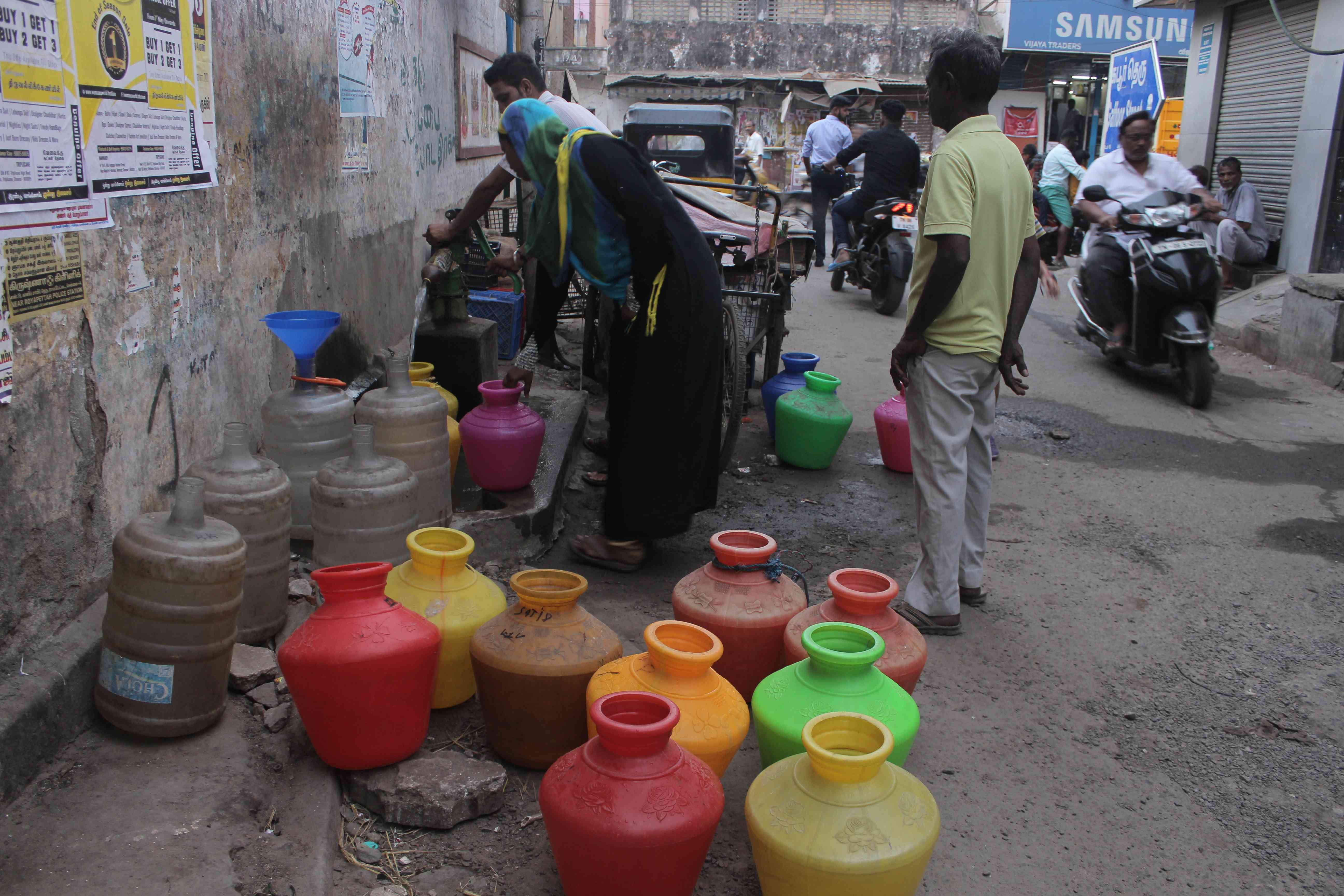 Residents wait their turn to fill water from a hand pump in Royapettah. Photo credit: S Senthalir