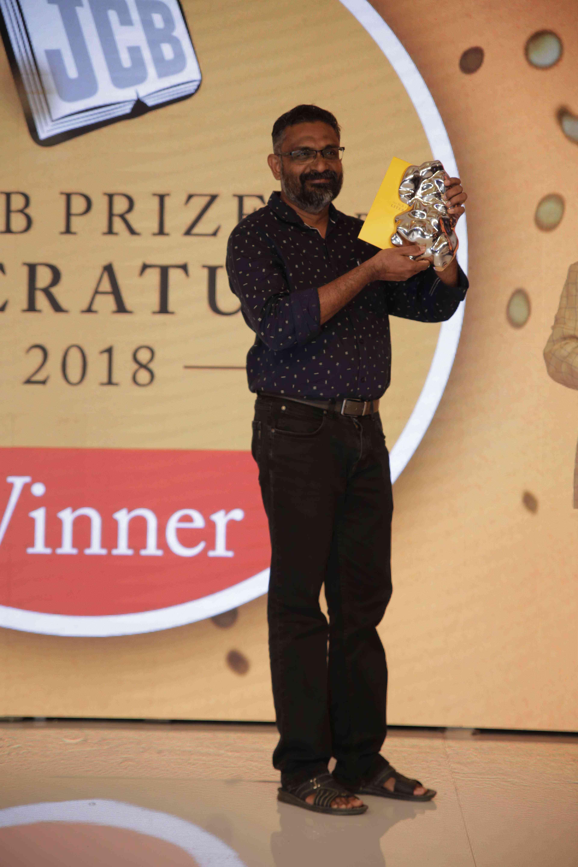 Benyamin with the JCB Prize for 'Jasmine Days'