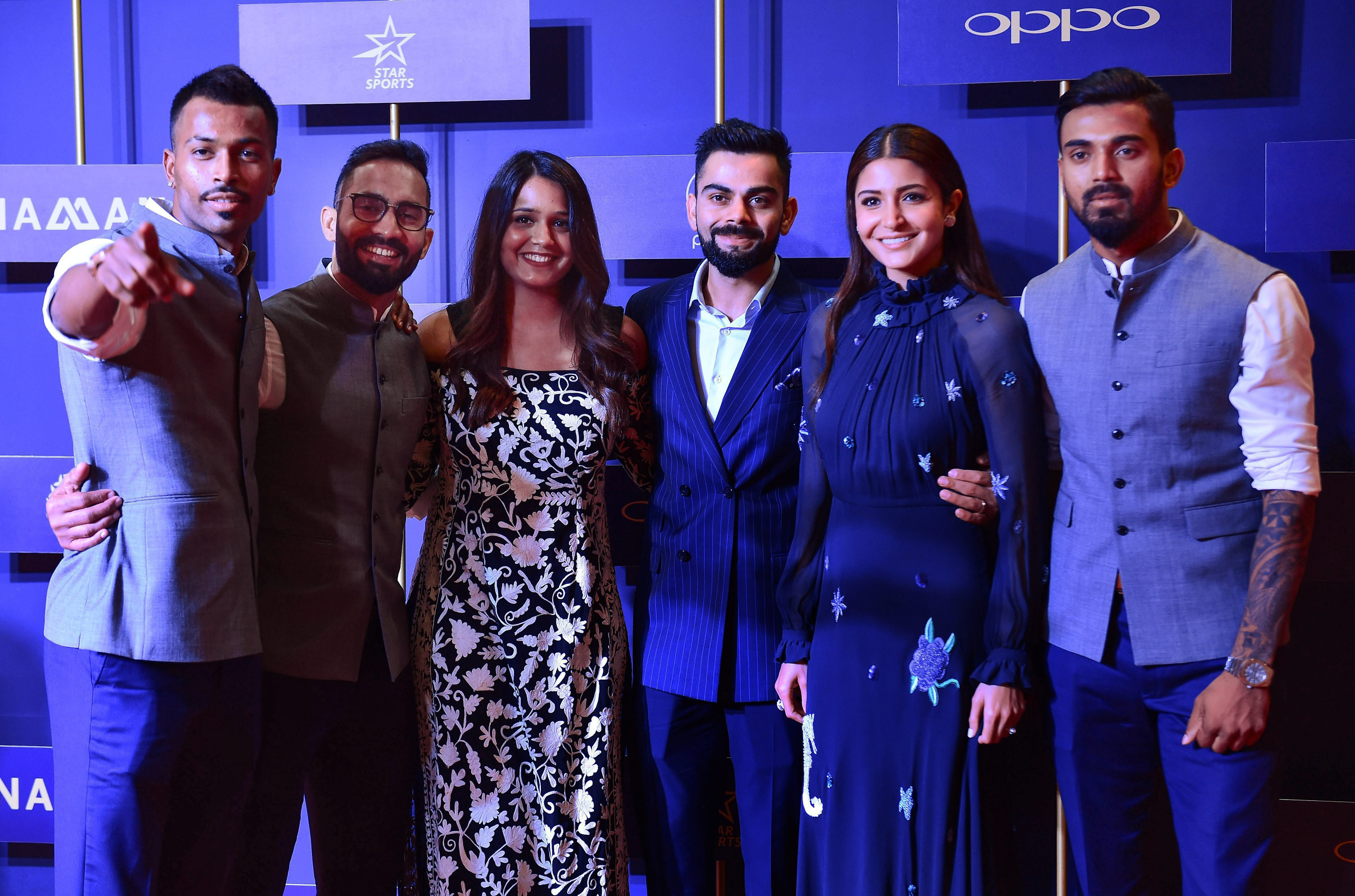 (L-R) India cricketer Hardik Pandya, wicketkeeper Dinesh Karthik with his wife and squash star Dipika Pallikal, Indian cricket captain Virat Kohli with his wife and Bollywood actor Anushka Sharma and cricketer KL Rahul pose for a group photograph during the BCCI annual awards, in Bengaluru on Tuesday. Photo: PTI