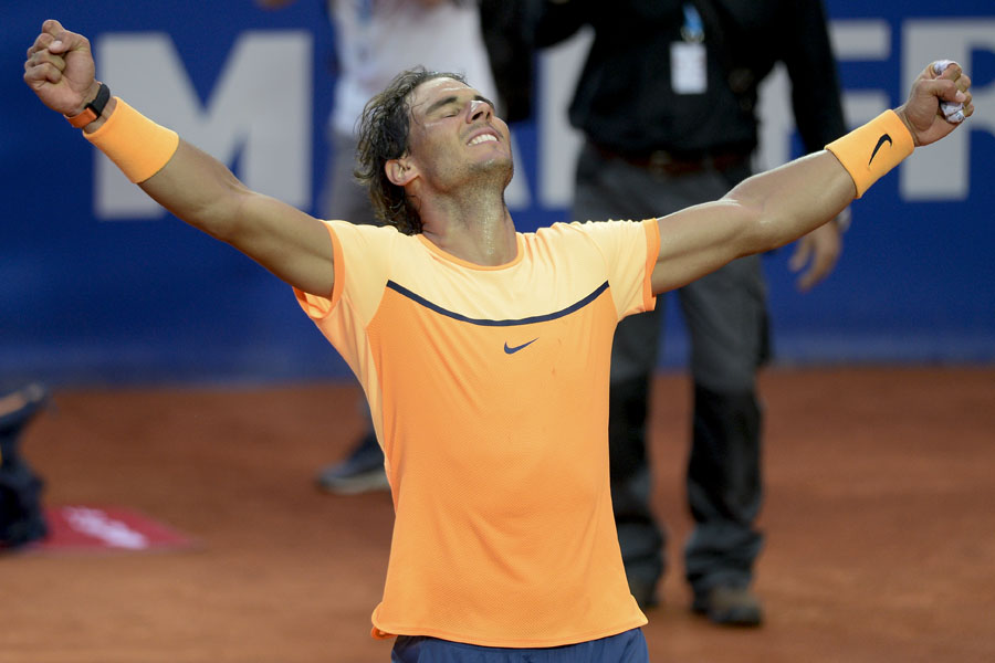 Rafael Nadal exults after winning the Barcelona Open and equalling Guillermo Vilas's record of 49 clay-court titles. Josep Lago/AFP
