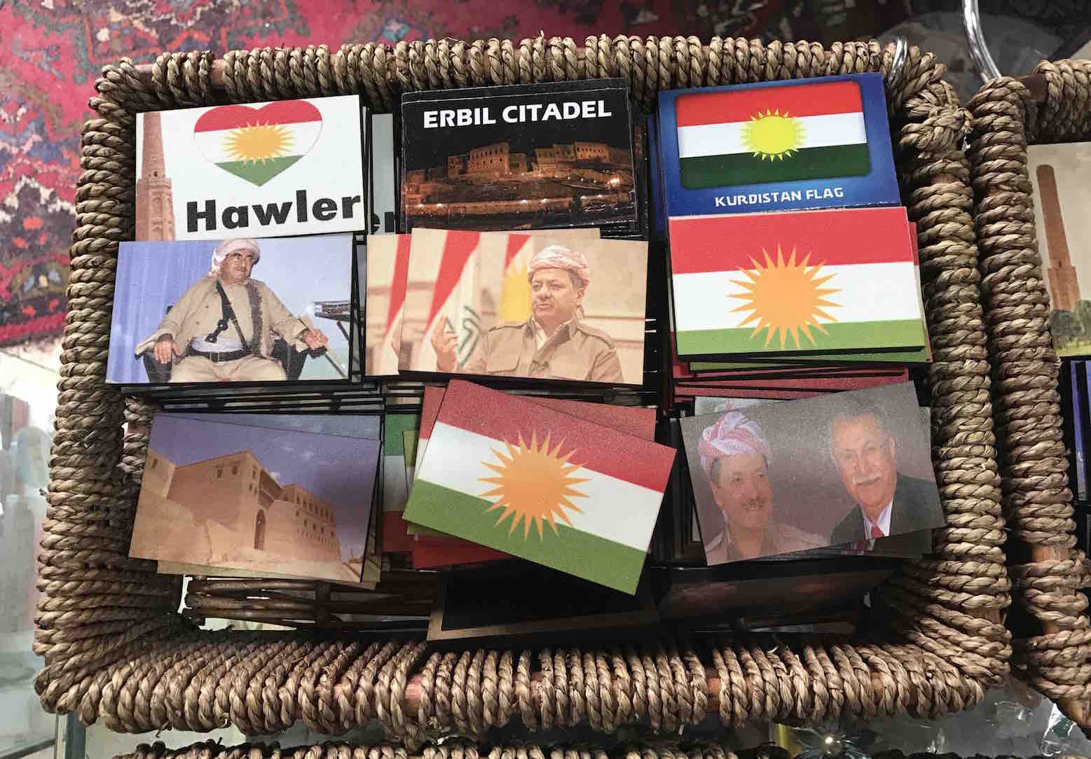 A souvenir shop sells fridge magnets showing the Kurdistan flag and its president Masoud Barzani.