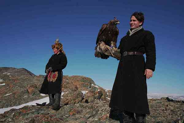 Todd Sampson with a Mongolian eagle hunter. Courtesy Discovery Channel.