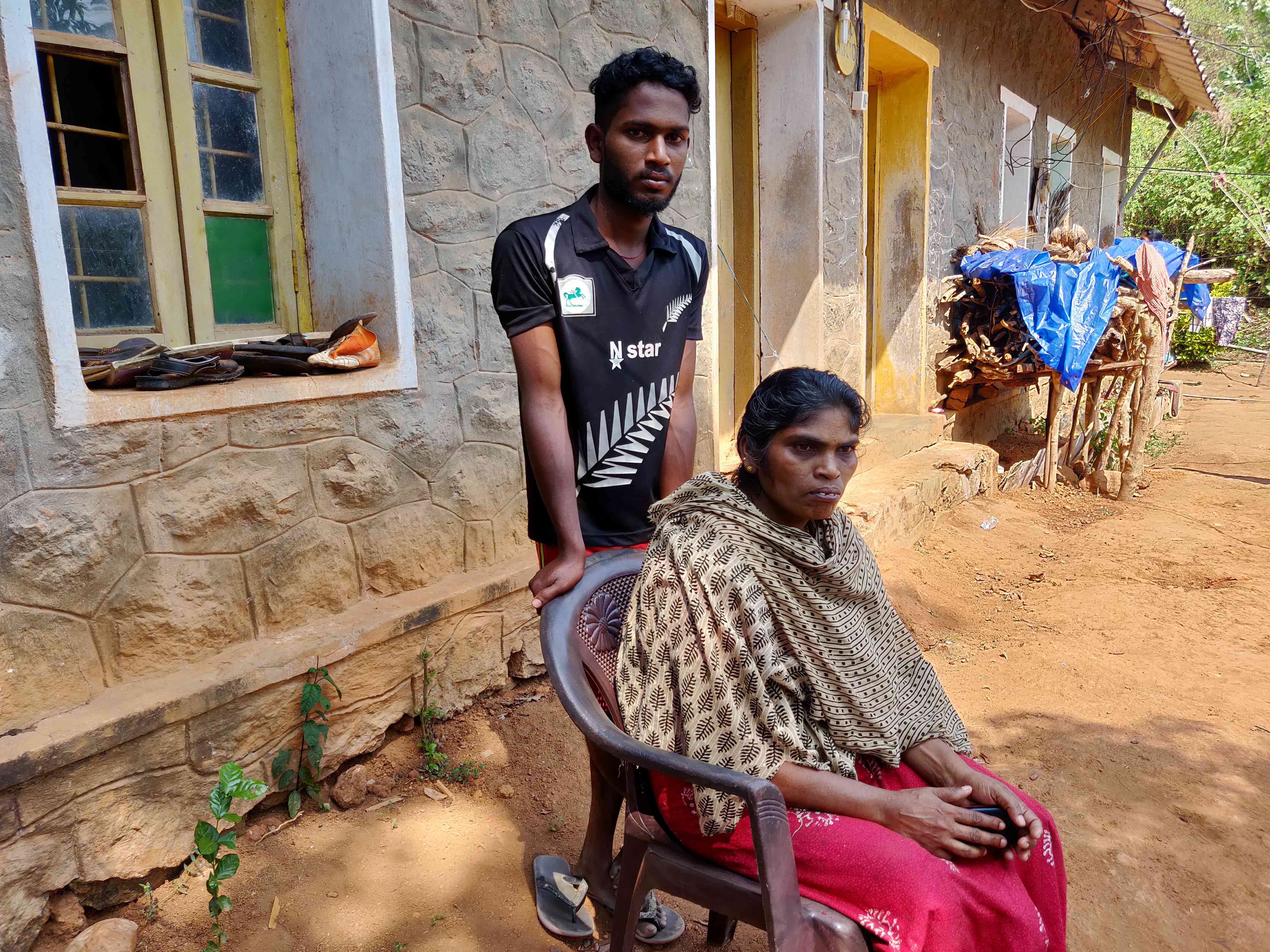 PJ Beena and his son at the relief camp in Idukki. Photo credit: TA Ameerudheen