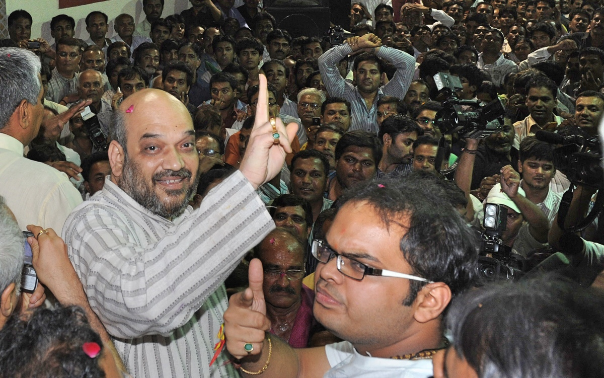 Amit Shah and his son Jay celebrate his arrival home after his release from Sabarmati Central Jail in Ahmedabad on October 29, 2010. (AFP/Sam Panthaky).