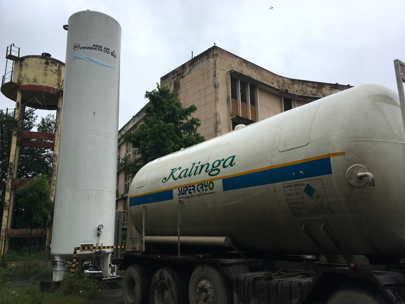 Trucks carrying liquid oxygen outside Gorakhpur hospital. Photo credit: Menaka Rao