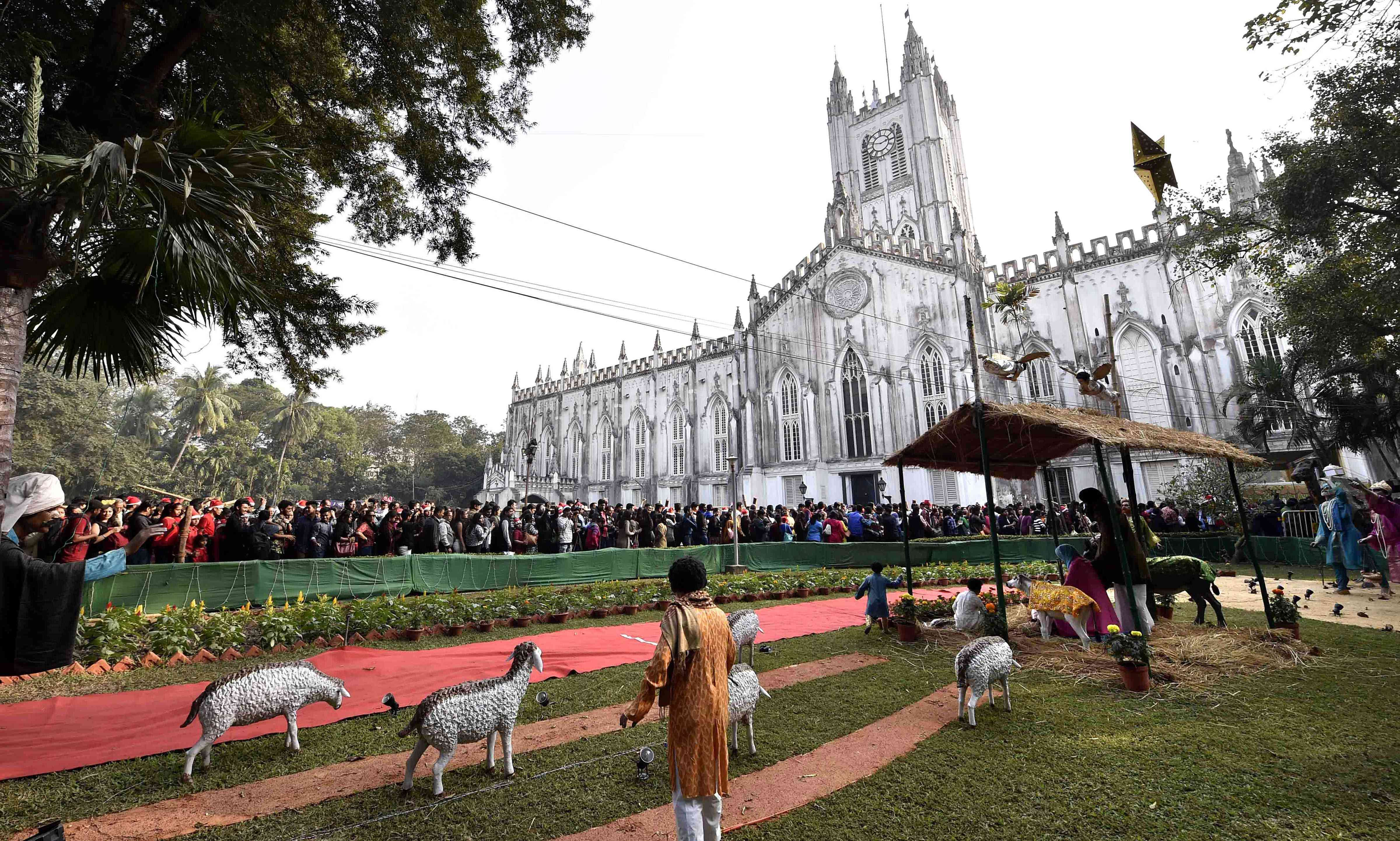 People wait outside the St Paul's Cathedral in Kolkata on Tuesday. (Photo credit: PTI)