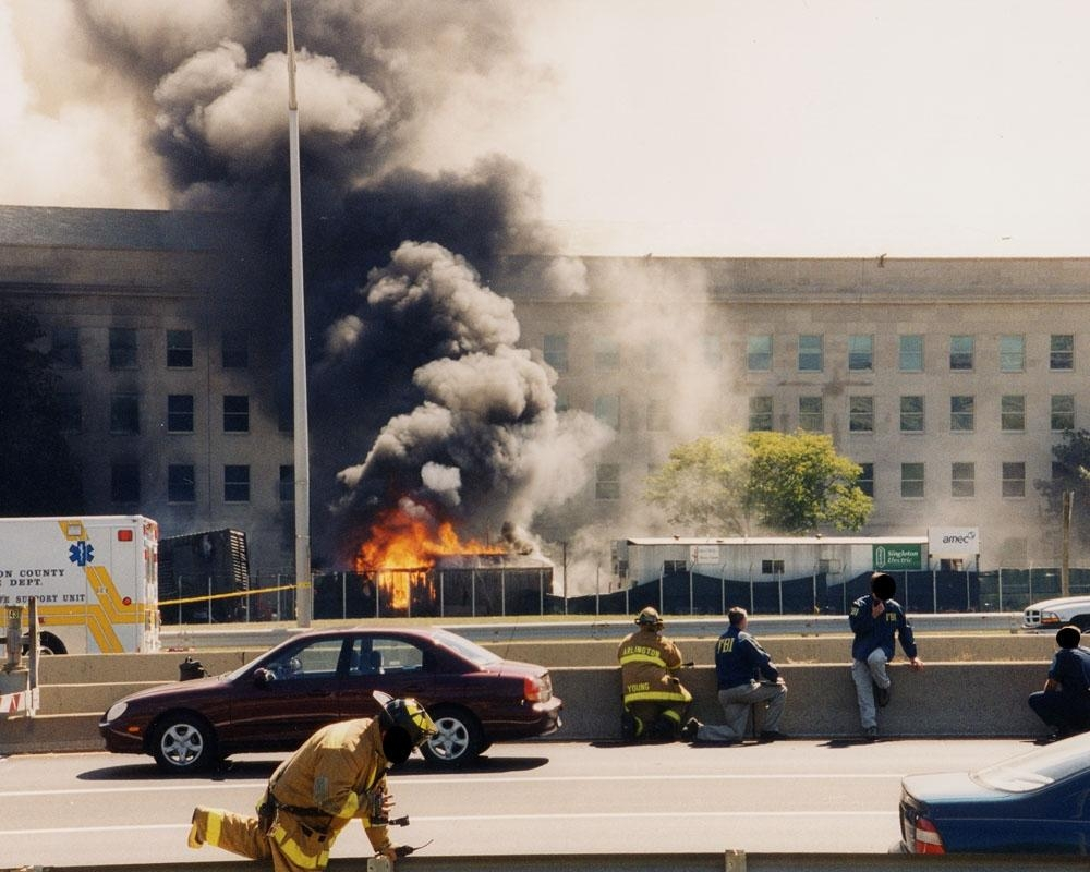 FBI personnel and rescue workers outside the smoking Pentagon shortly after the attack on 9/11. (Pic: FBI)