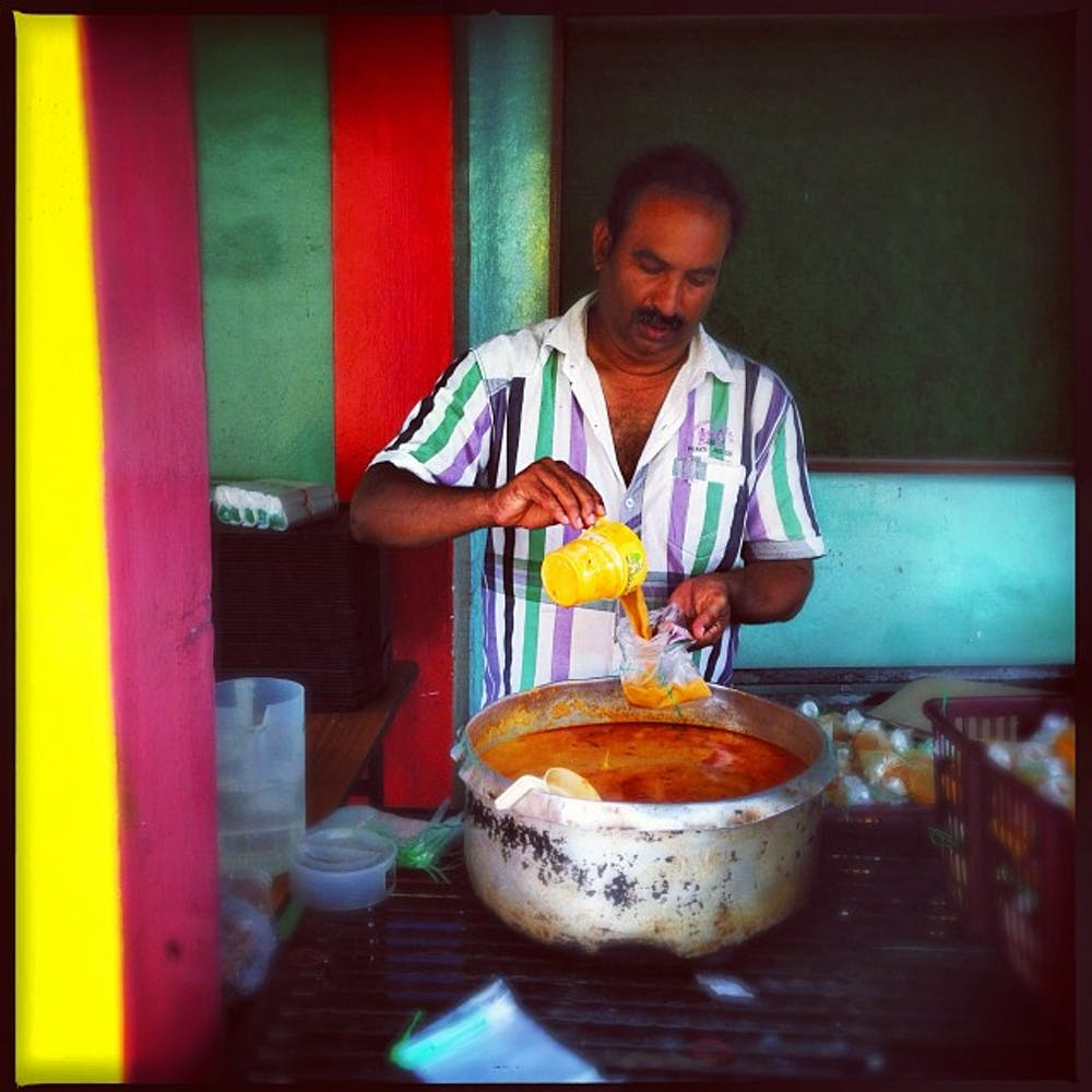 A Singaporean curry purveyor. Photo Credit: Jonathan Ooi/flickr