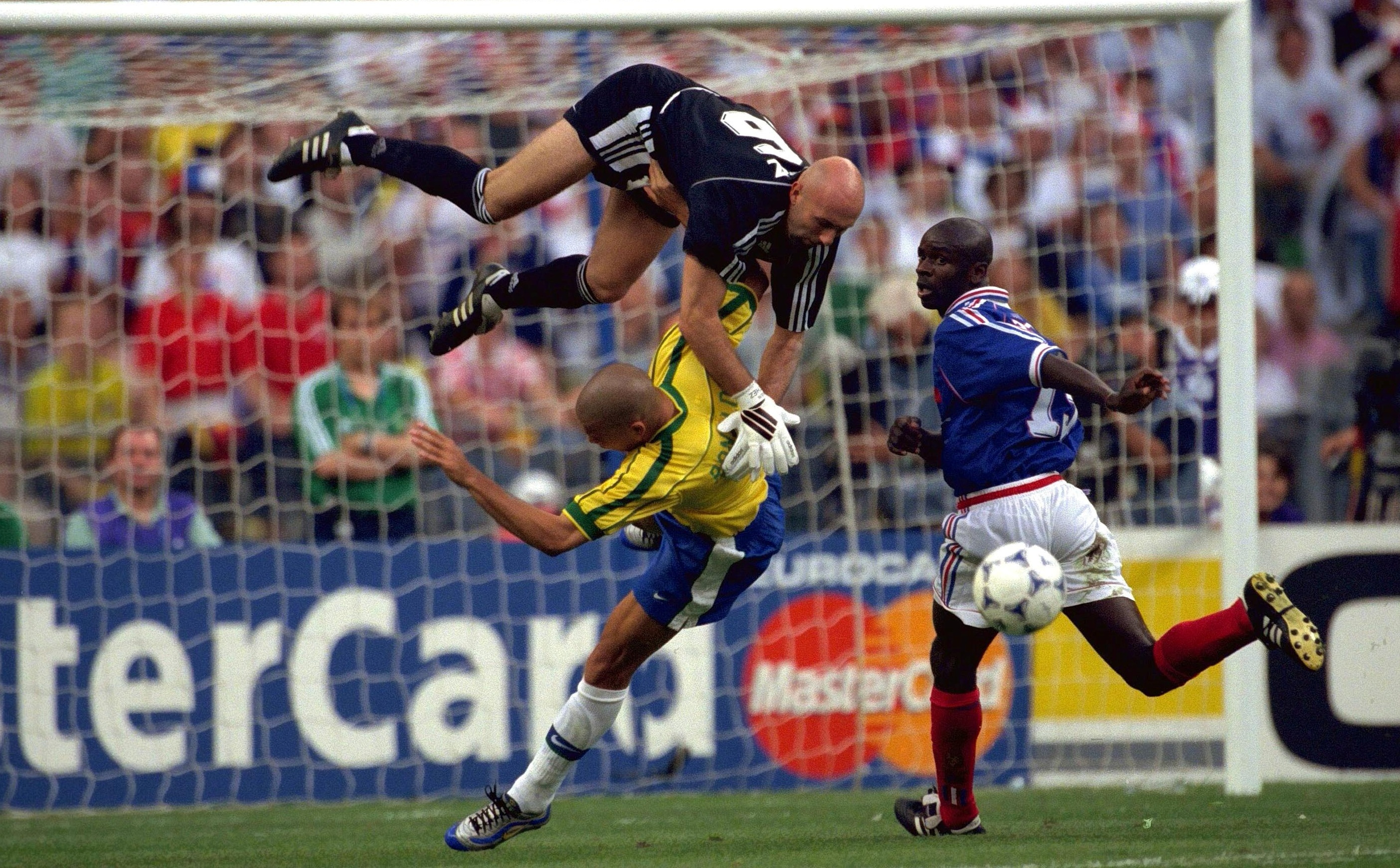 95c1b36e0 Ronaldo (centre) was injured after a clash with France goalkeeper Fabian  Barthez