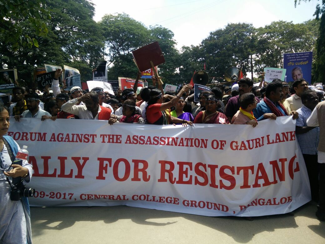 Members of the Forum against the Assassination of Gauri Lankesh hold up a banner. (Credit: Archana Nathan/Scroll.in)
