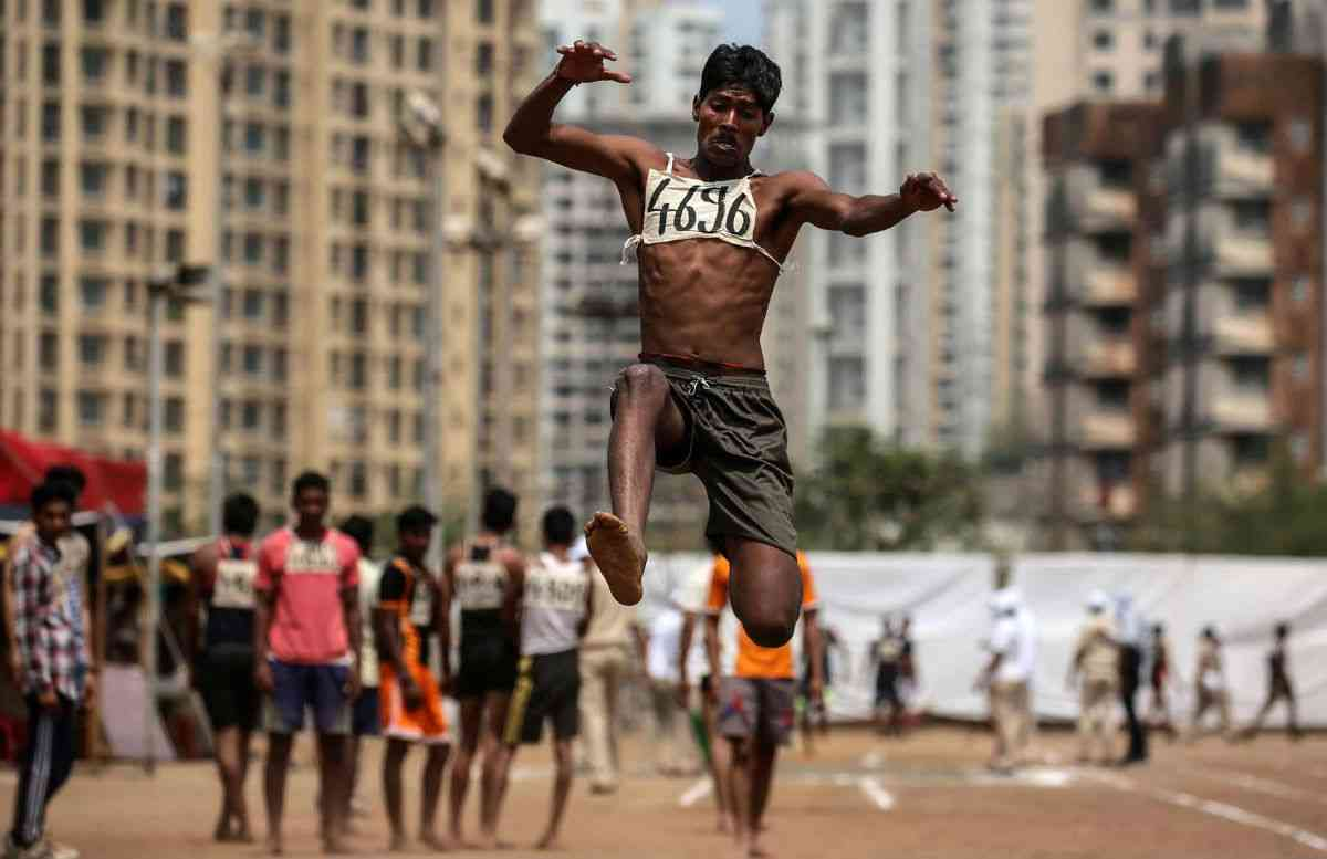A participant at a long-jump event during the Mumbai Police recruitment drive at Gaondevi Maidan in Thane. Photo credit: Divyakant Solanki/European Press Photo Agency.
