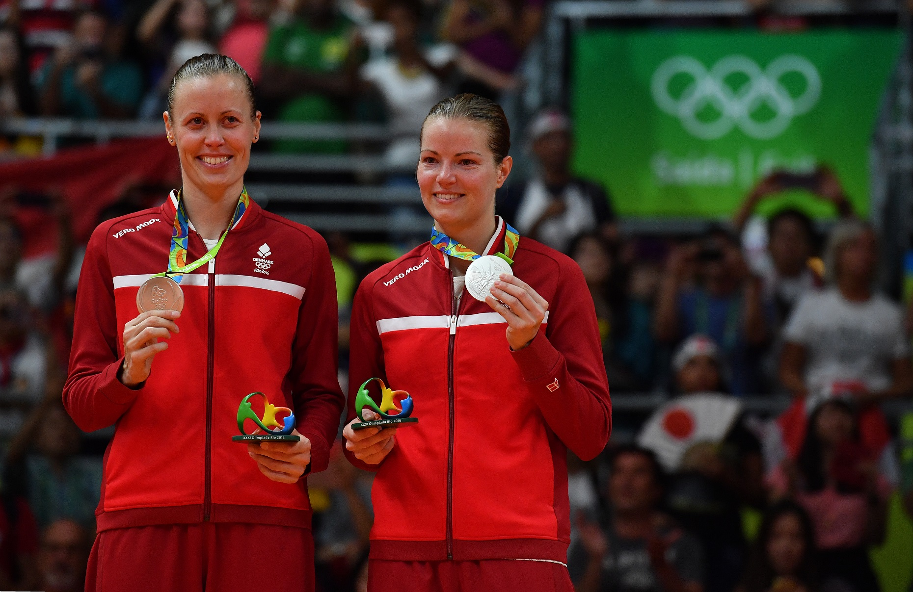 Kamilla and Christinna with their silver medals in the Rio Olympics. -AFP