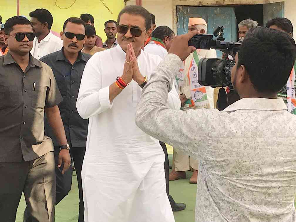 Praful Patel arrives for a campaign rally in Asgaon village in Bhandara district.