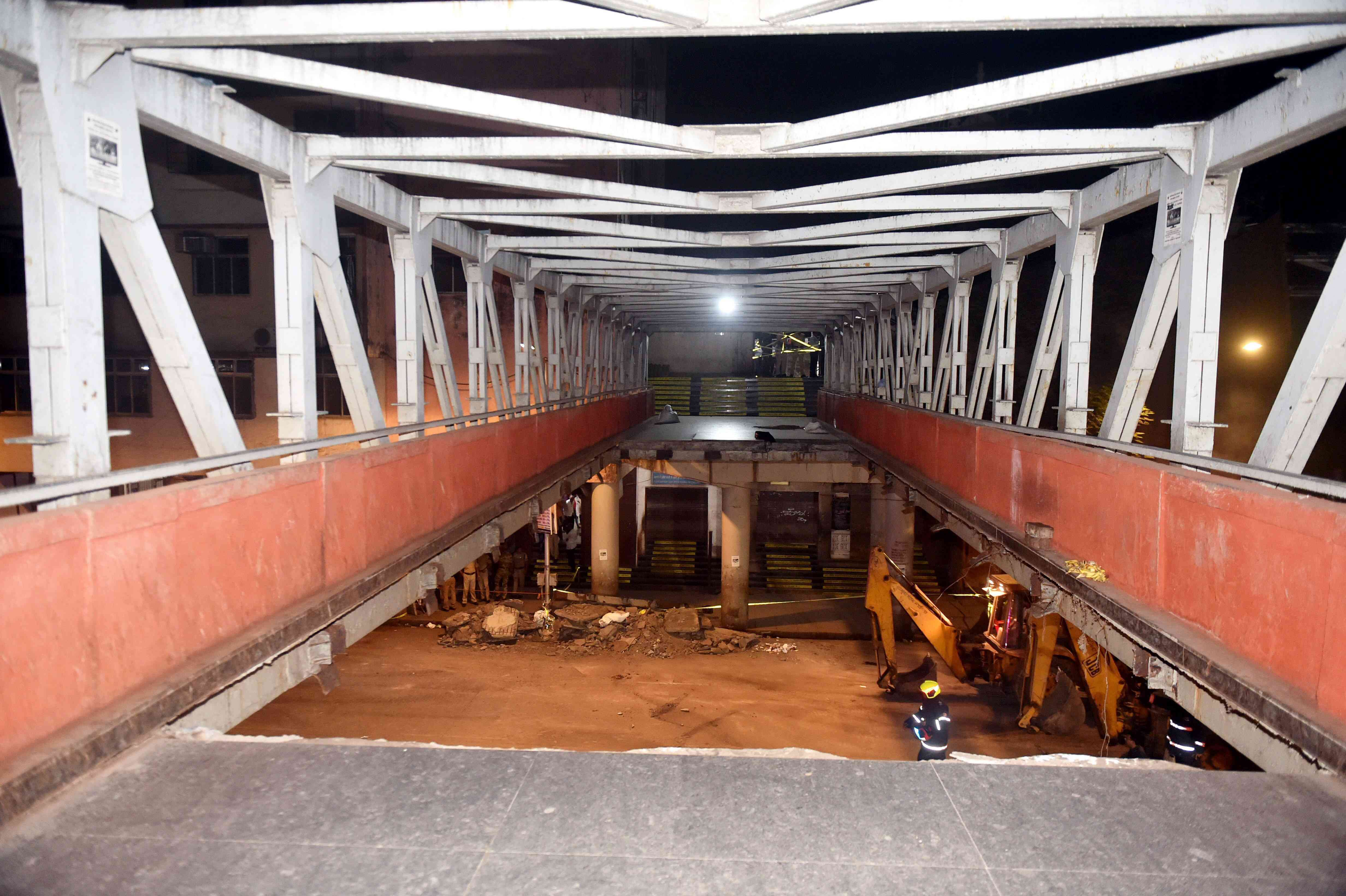 The damaged section of the foot overbridge that caved in on Thursday. (PTI Photo)