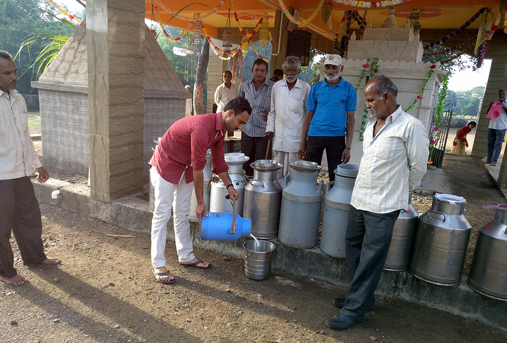 People from nearby villages donate milk for the festival. Photo credit: Riddhi Doshi