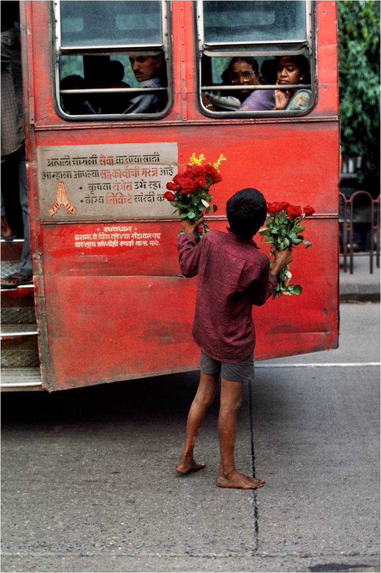 Young boy sells flowers, 1993. (Photograph by Steve McCurry. Courtesy Phaidon/Roli Books)