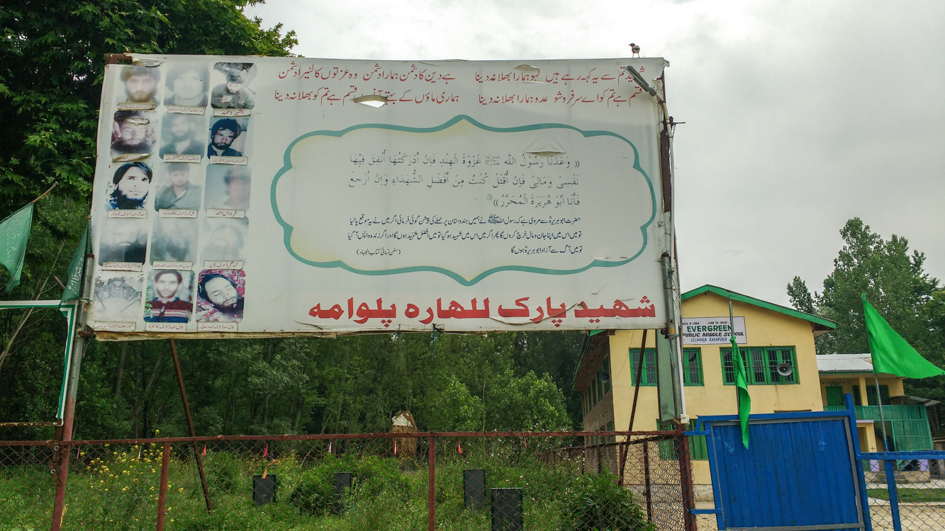 A billboard with the photographs of slain militants in South Kashmir's Pulwama district.