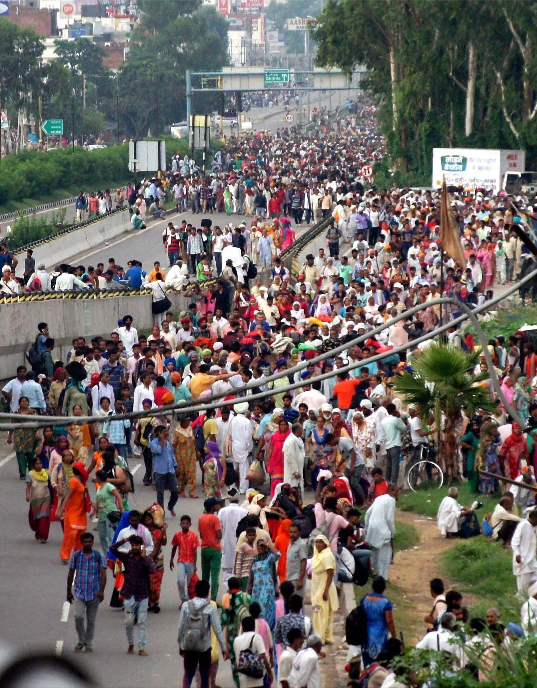 Minutes before the violence began, followers of Dera chief Ram Rahim gathered on the streets after his conviction was announced. (Credit: PTI)