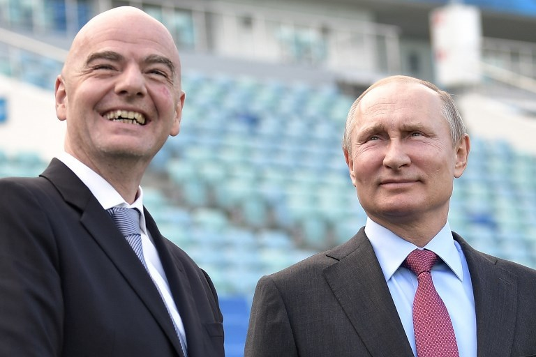 Gianni Infantino and Vladimir Putin have a lot at stake (Image: AFP)