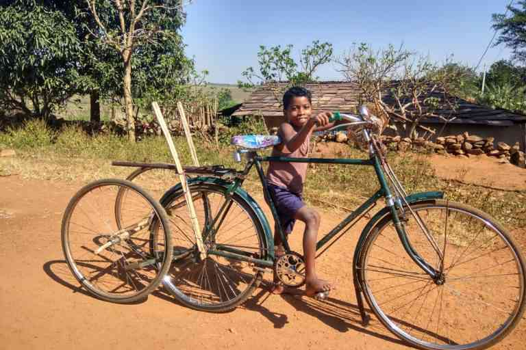 One of the students on his self made fun-ride in Manjhipara village. Photo Credit: Mayank Aggarwal/Mongabay-India