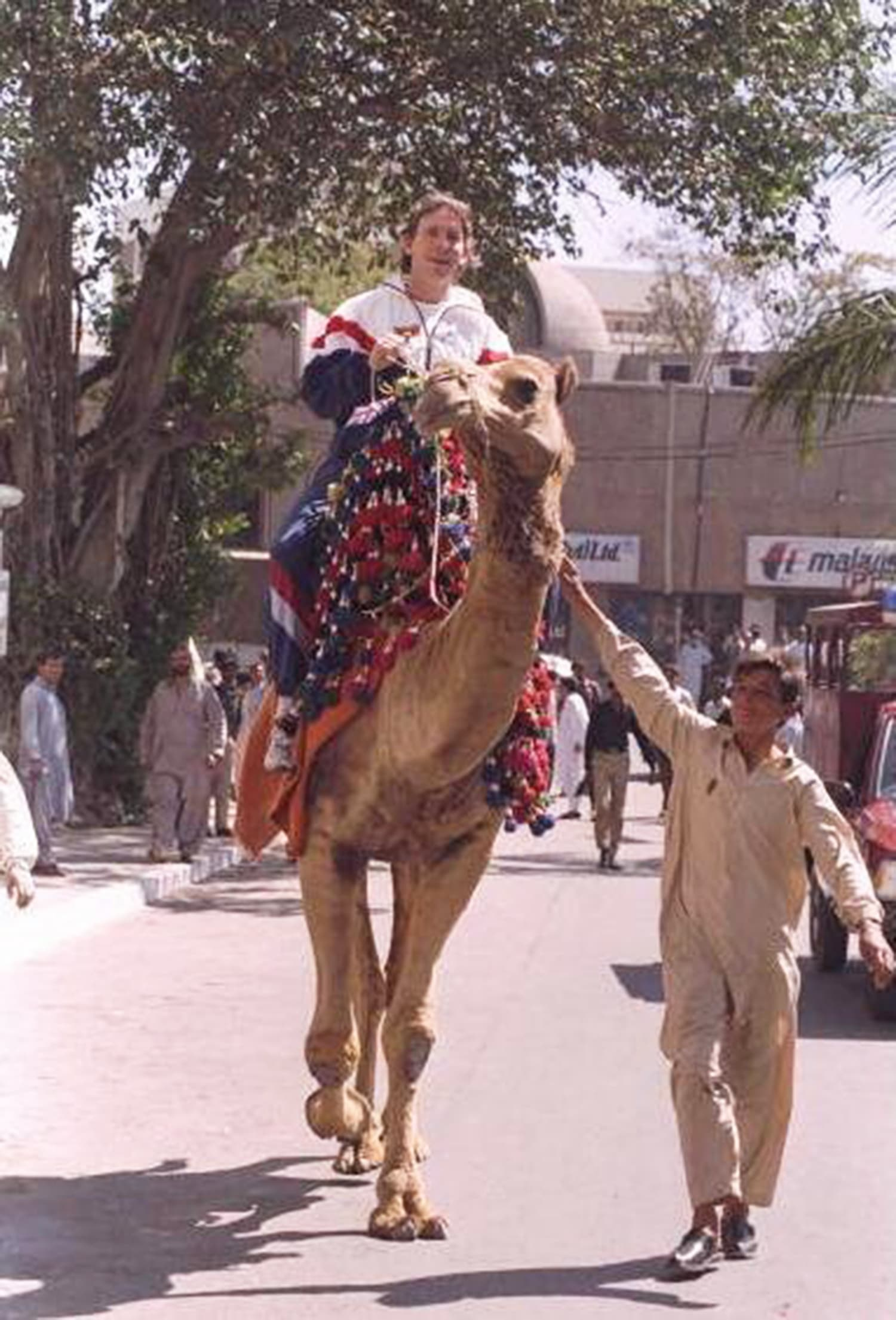 England cricketer Dermot Reeve enjoys a camel ride in Karachi.