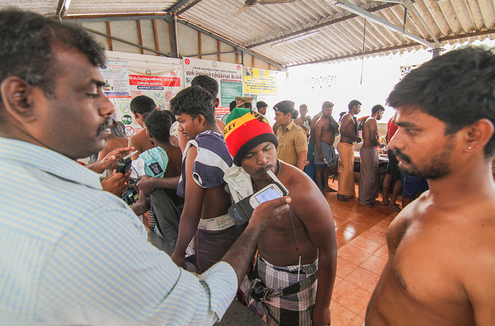 A player undergoes an alcohol test at a primary health centre, close to the jallikattu venue at Alanganallur. Strict guidelines, mandating alcohol tests and weight checks, were introduced after allegations were made that players came to the arena inebriated.