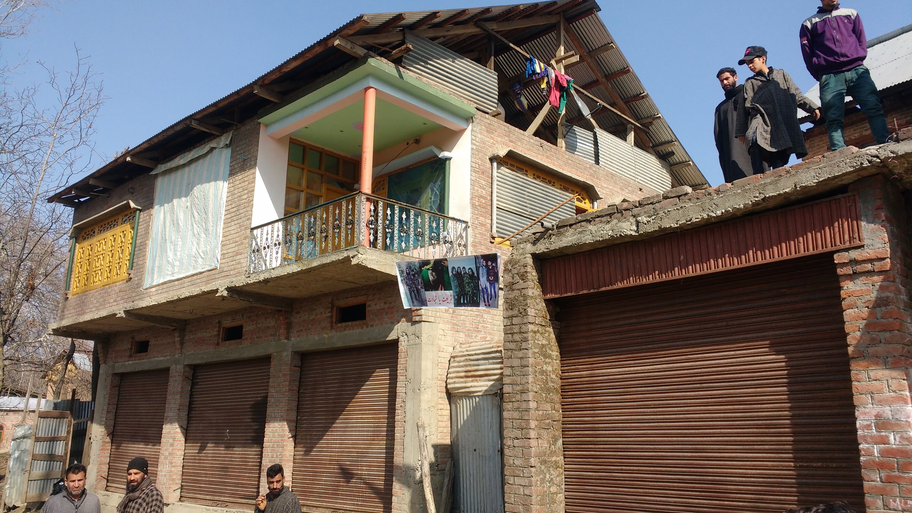 Broken windows in Ganowpora village. Image: Rayan Naqash