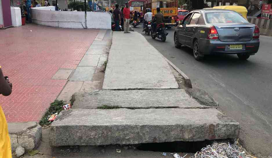 A precariously positioned slab, high step and footpath that ends abruptly forcing pedestrians to step onto the road. Credit: The Footpath Initiative