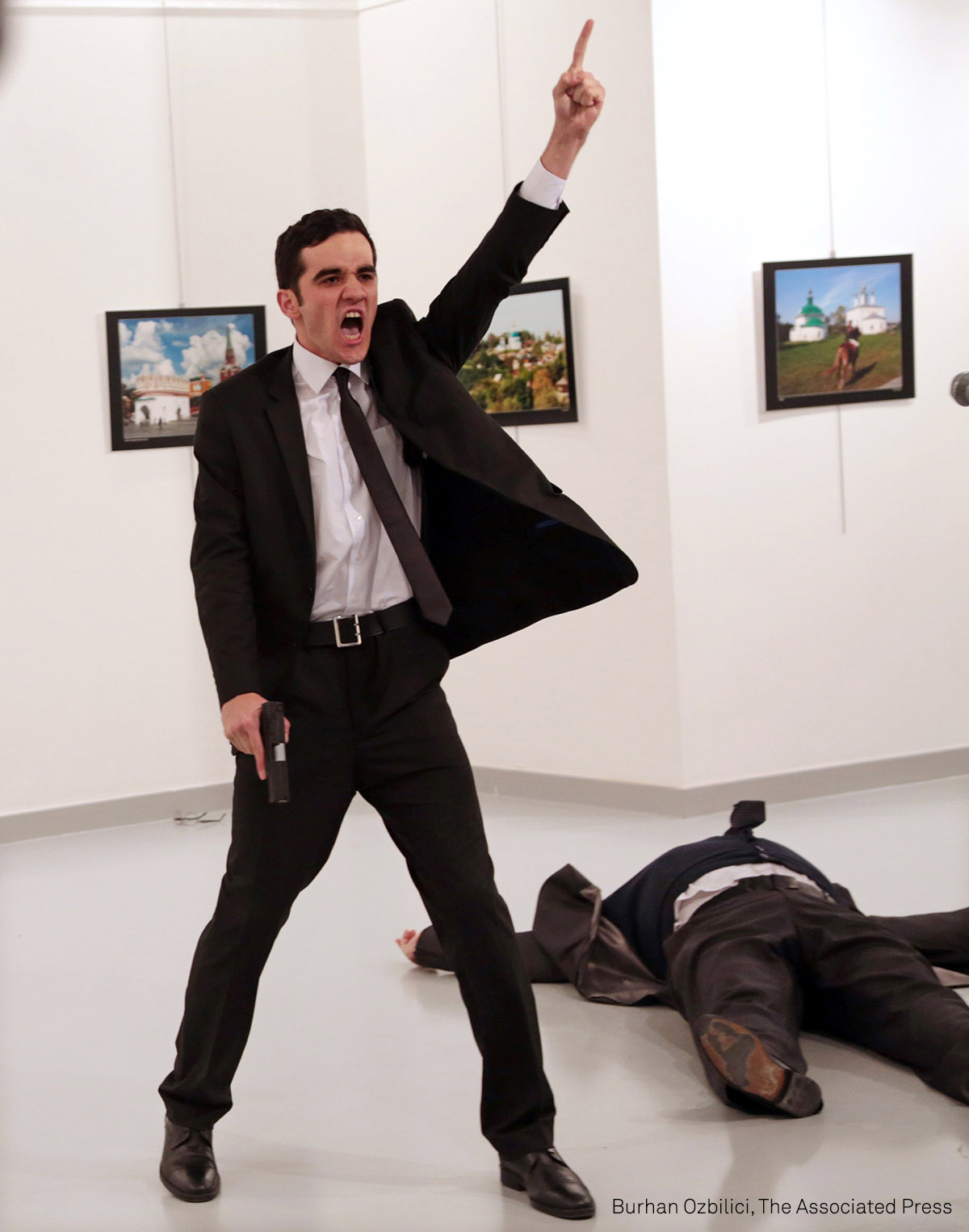 World Press Photo of the Year | An Assassination in Turkey: Mevlut Mert Altintas shouts after shooting Andrei Karlov, the Russian ambassador to Turkey, at an art gallery in Ankara, Turkey, in December 2016. (AP Photo/Burhan Ozbilici).