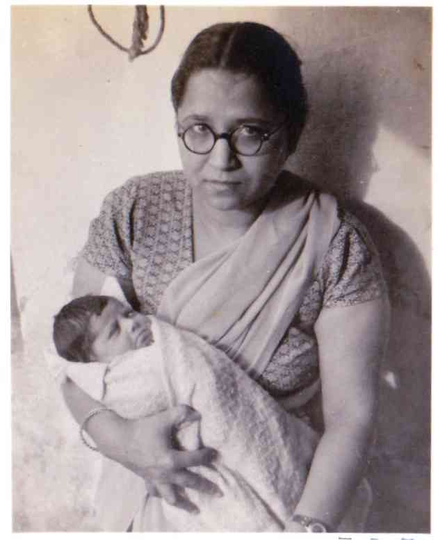 Dr Hari J Mirchandani, carrying Meena, her brother's daughter, whom she had delivered two days ago in Delhi in 1950.