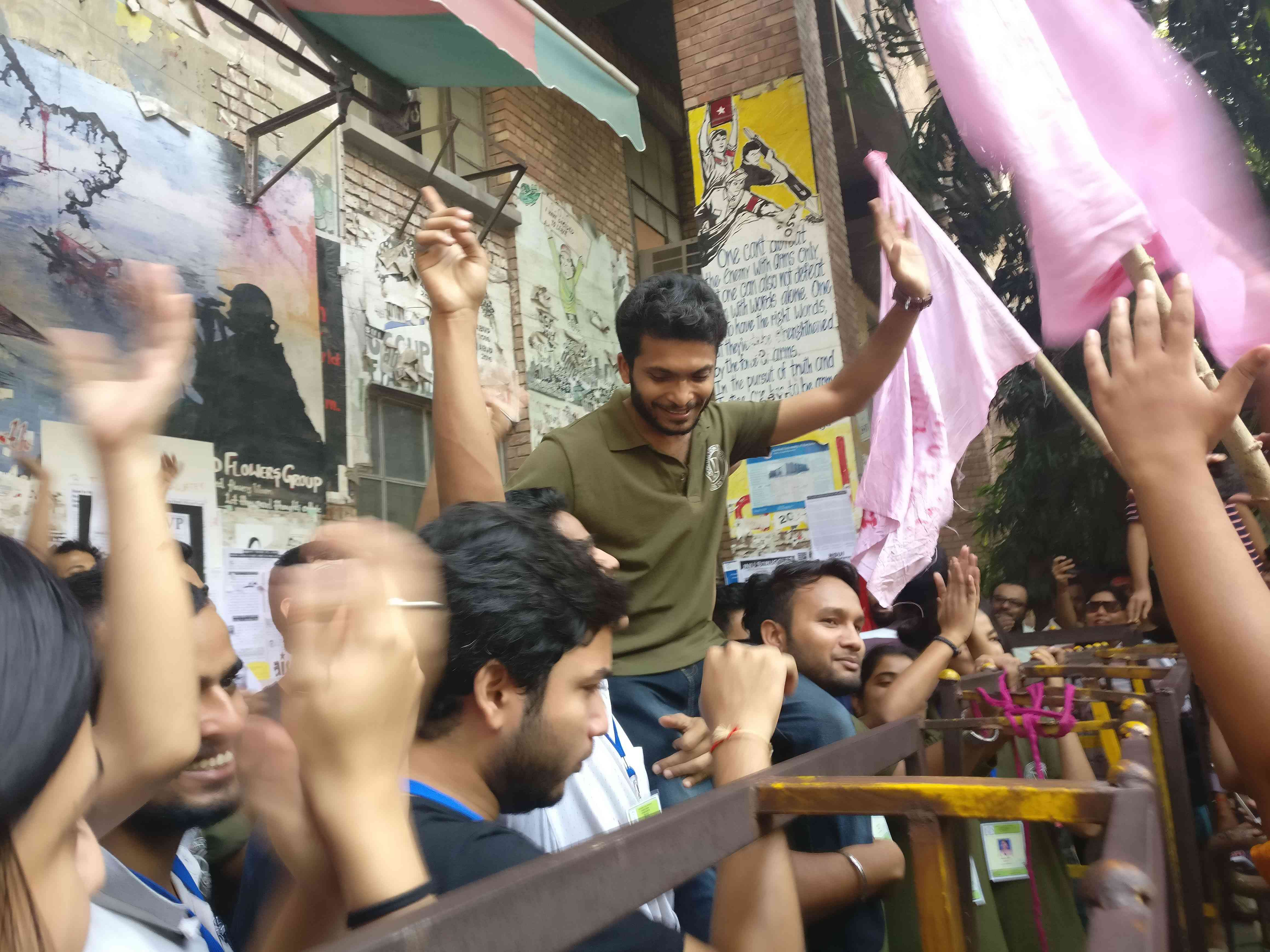 "Himanshu Kulshrestha, the election committee chairman, was cheered after the team emerged from the counting centre. He thanked the ""JNU community for their support in conducting the elections"". (Photo credit: Shreya Roy Chowdhury.)"