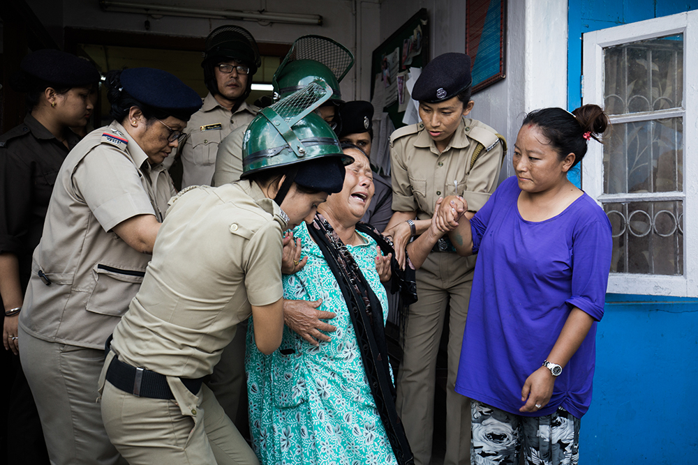 The mother of a protester in detention cries at the police station in Kalimpong on June 15. Photo: Praveen Chettri