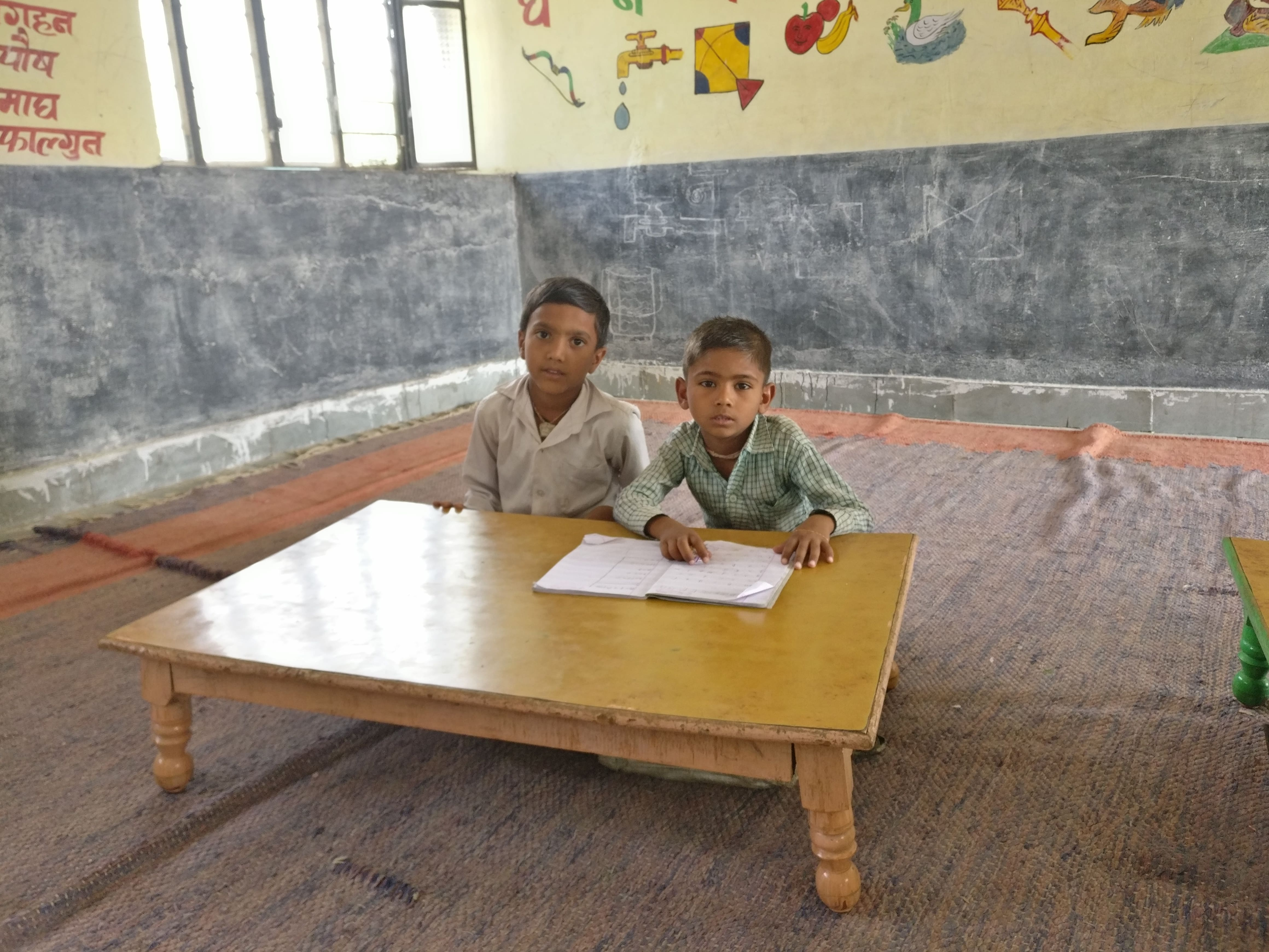 Sajjan Singh (left), in Class 2, has no one to walk with on the hour-long commute to school.