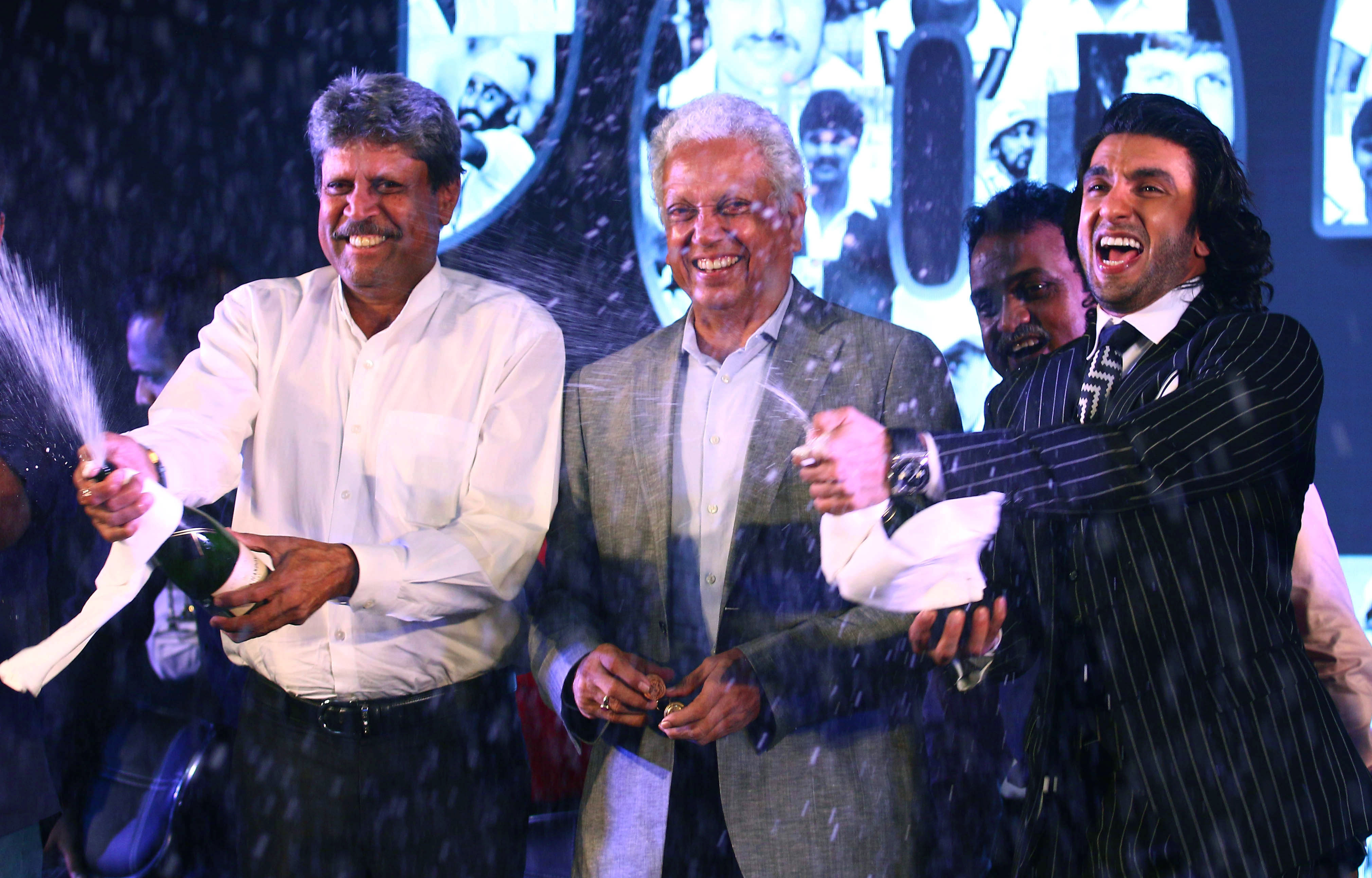 Kapil Dev, Mohinder Amarnath and Ranveer Singh at the launch of 1983 / AFP
