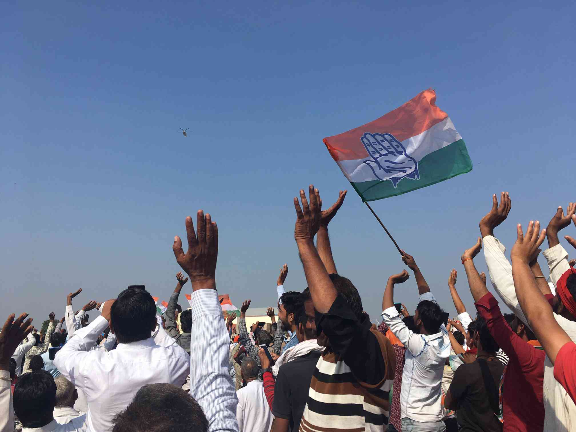 Congress supporters wave at Rahul Gandhi's helicopter in Chittorgarh. Rajputs in Mewar seem to be gravitating towards the Congress in these elections.