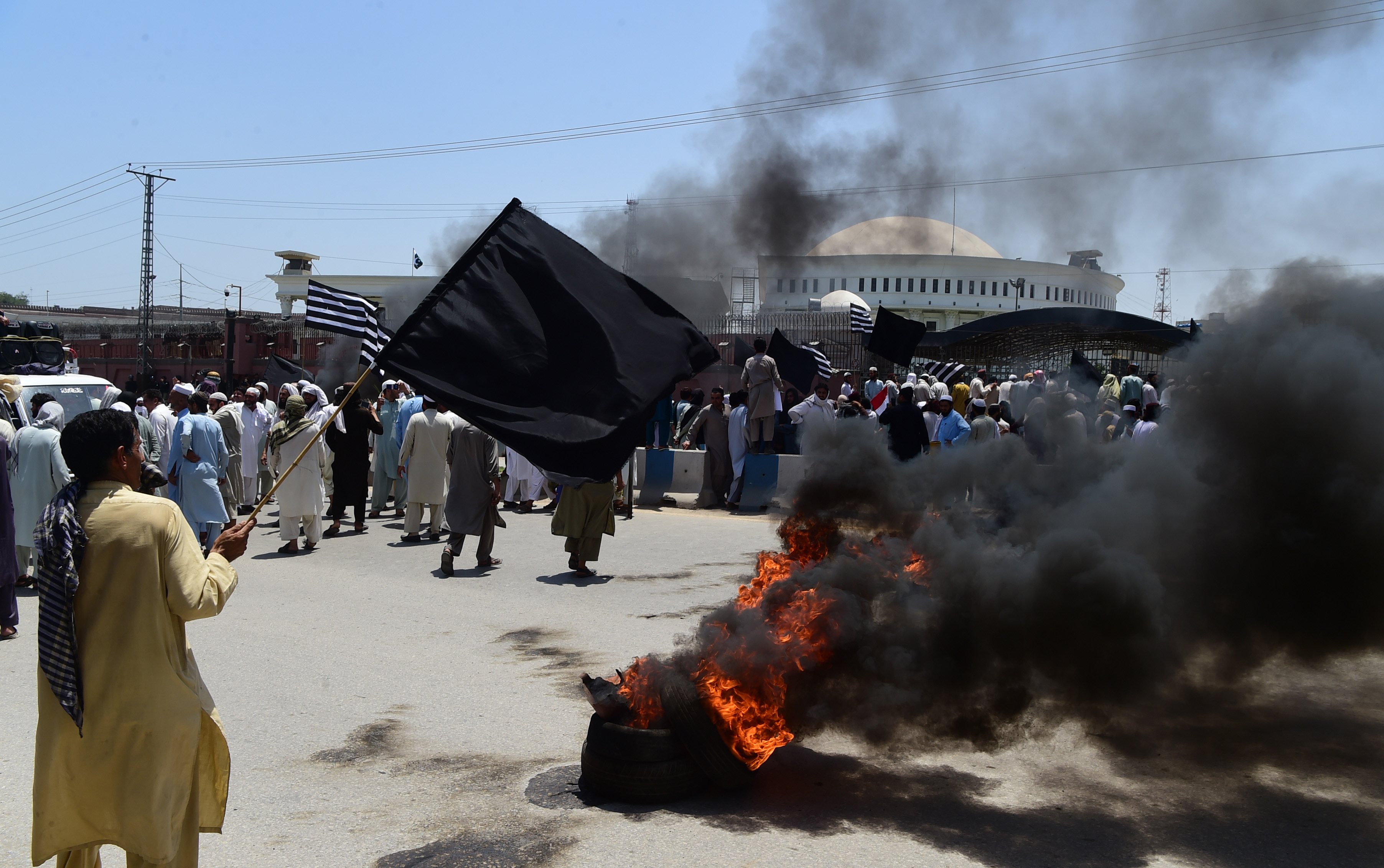 Supporters of the Jamiat Ulema-e-Islam-Fazl party protest against the merger in Peshawar. Photo credit: AFP