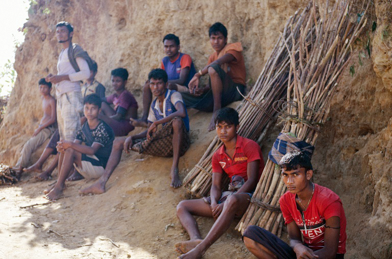 A group of Rohingya men take a break on the long route home from collecting firewood from Bangladeshi forests. Photo credit: Kaamil Ahmed/Mongabay