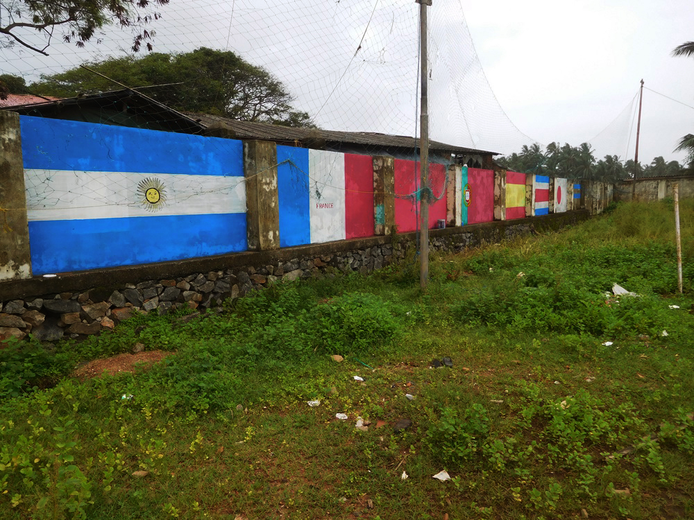 A wall in Ninan Valappu village is painted in the colours of prominent teams in the Word Cup. (Photo credit: TA Ameerudheen).