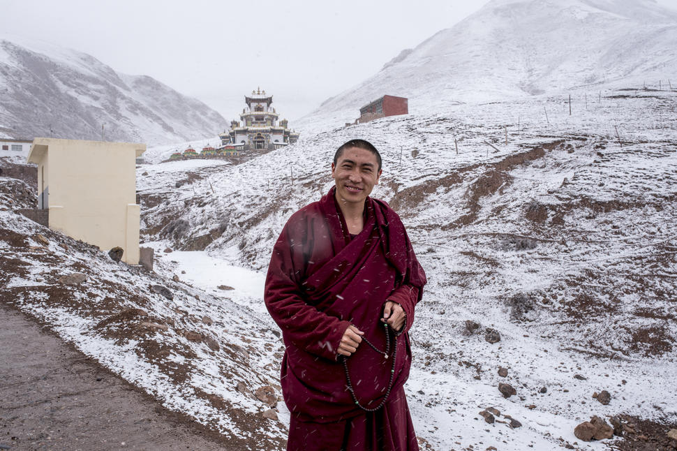 Living Buddha and environmental activist, Lama Trinli Gyatso, stands outside his home in the mountains surrounding Zado, Tibet (Qinghai, China).