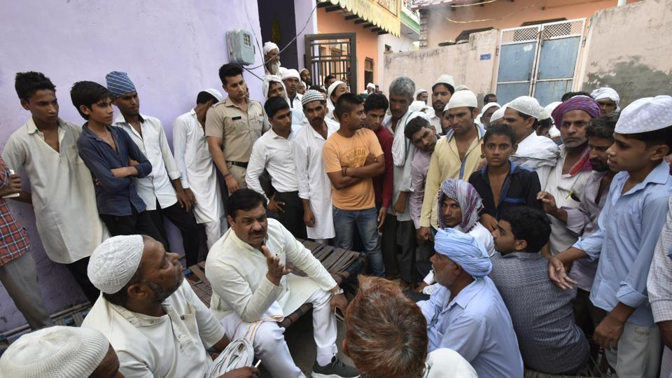 Neighbours gather outside Junaid's home in Khandawli in Faridabad on Friday. Photo credit: Ravi Choudhary/HT Photo